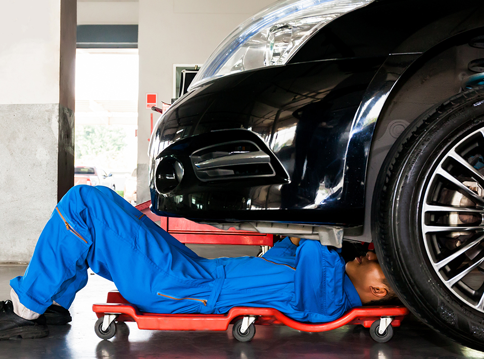Mechanic under a vehicle doing repairs - Servicing, Tyres & Repairs Edenbridge