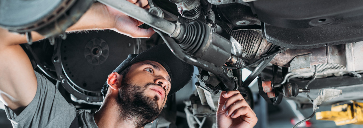 A mechanic looking inside a vehicle - Car Repairs Edenbridge